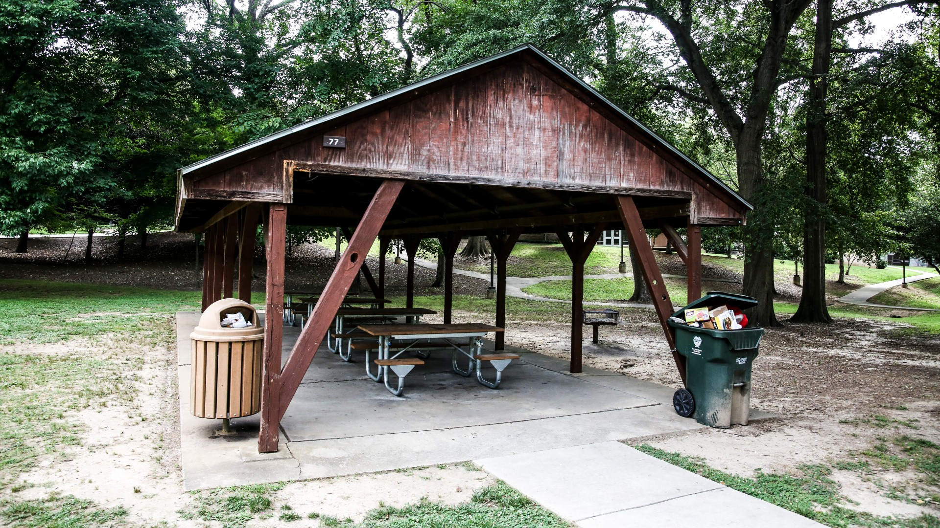 A second outdoor picnic shelter with six tables