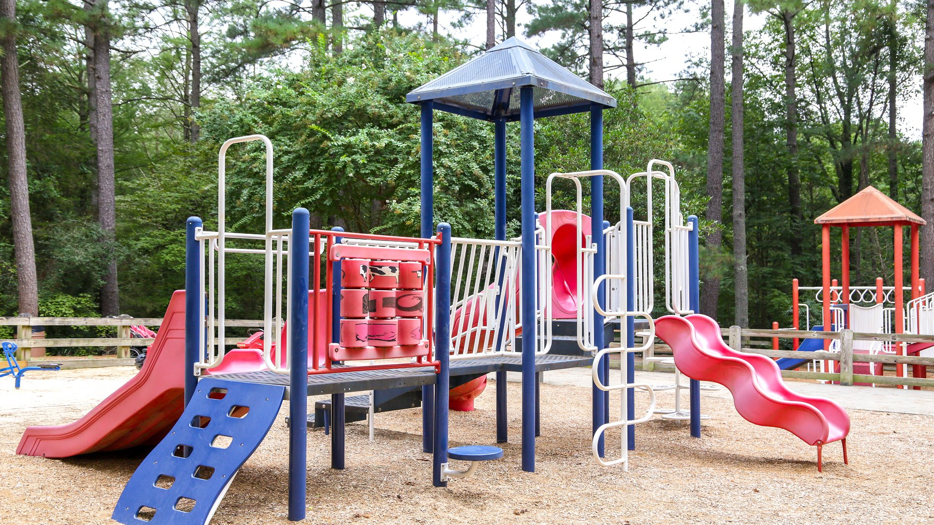 One of two playgrounds designed for younger kids with slides and climbing surface
