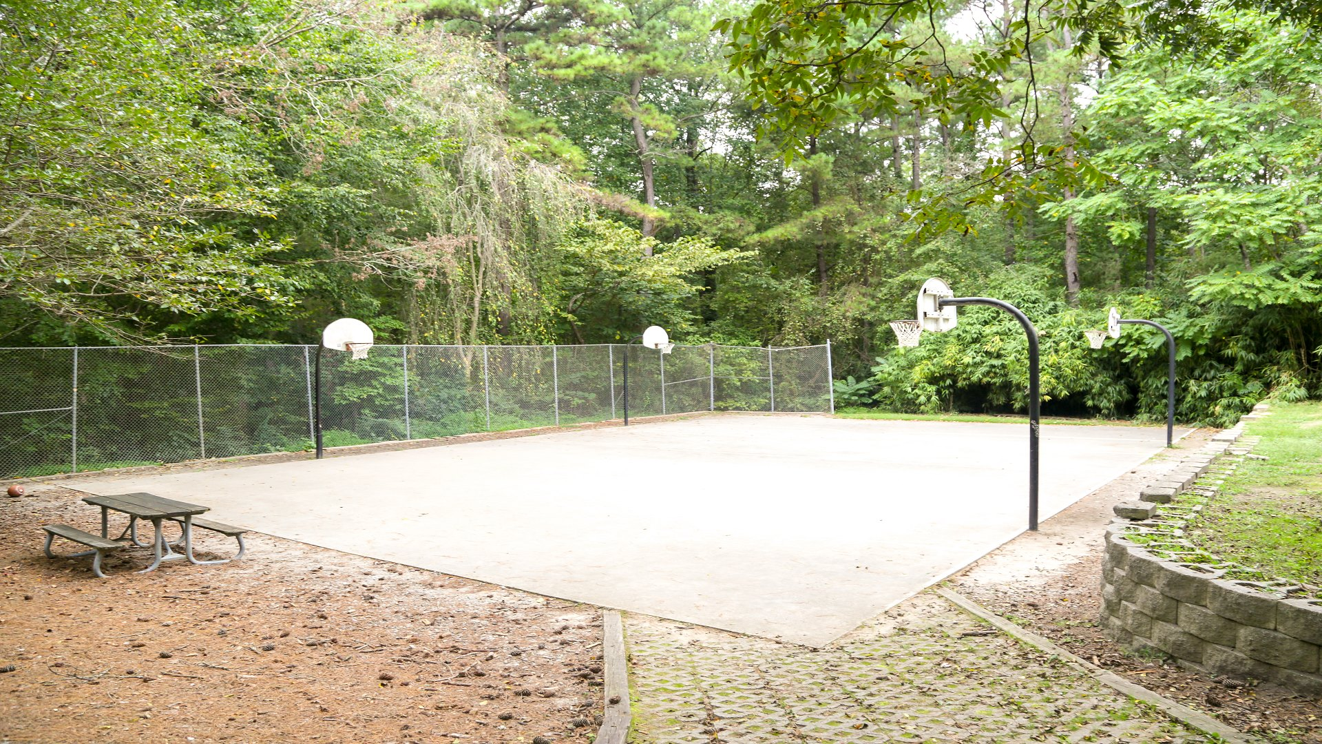 Outdoor basketball courts with concrete surface