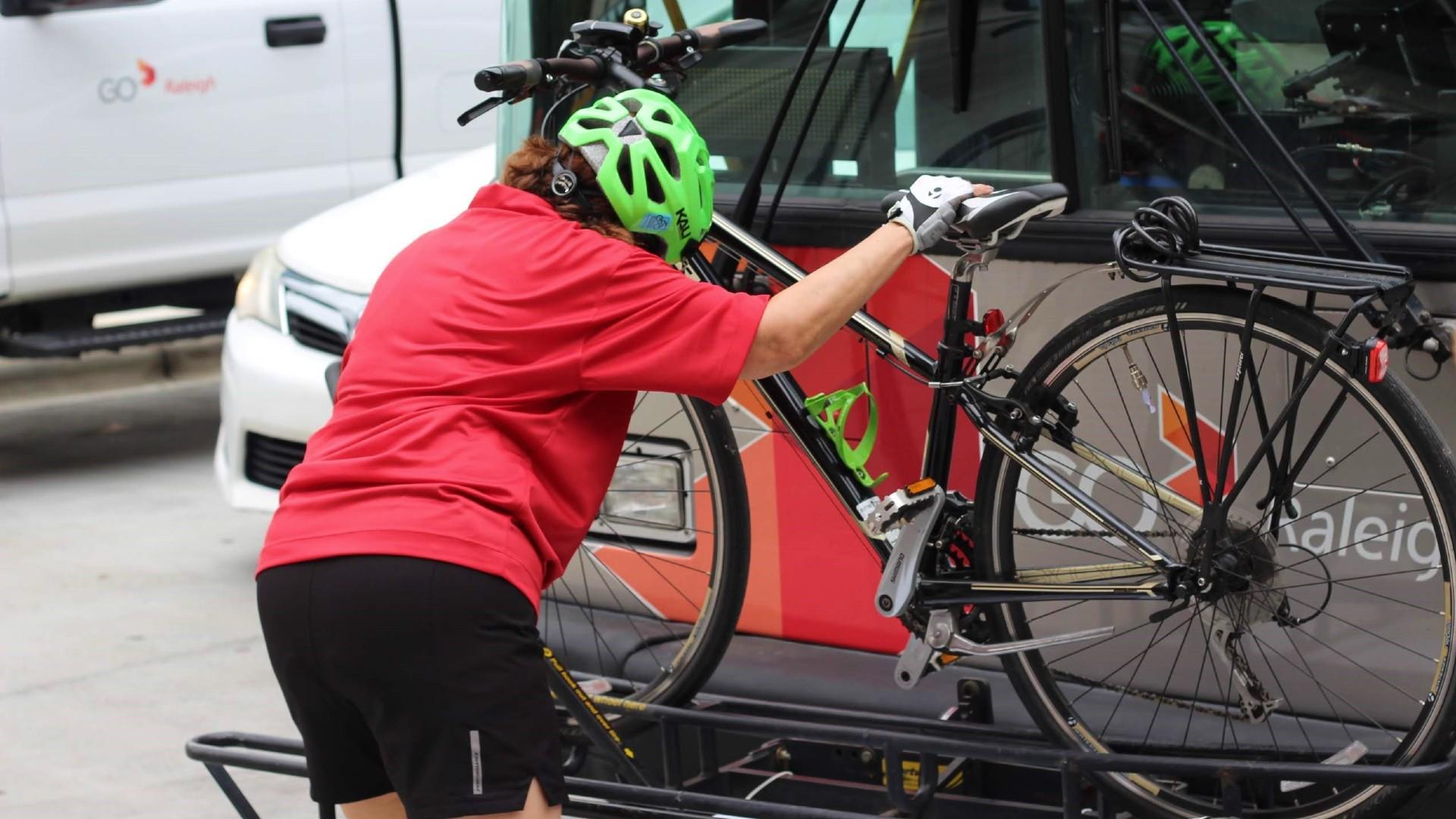 Woman using bus bike rack