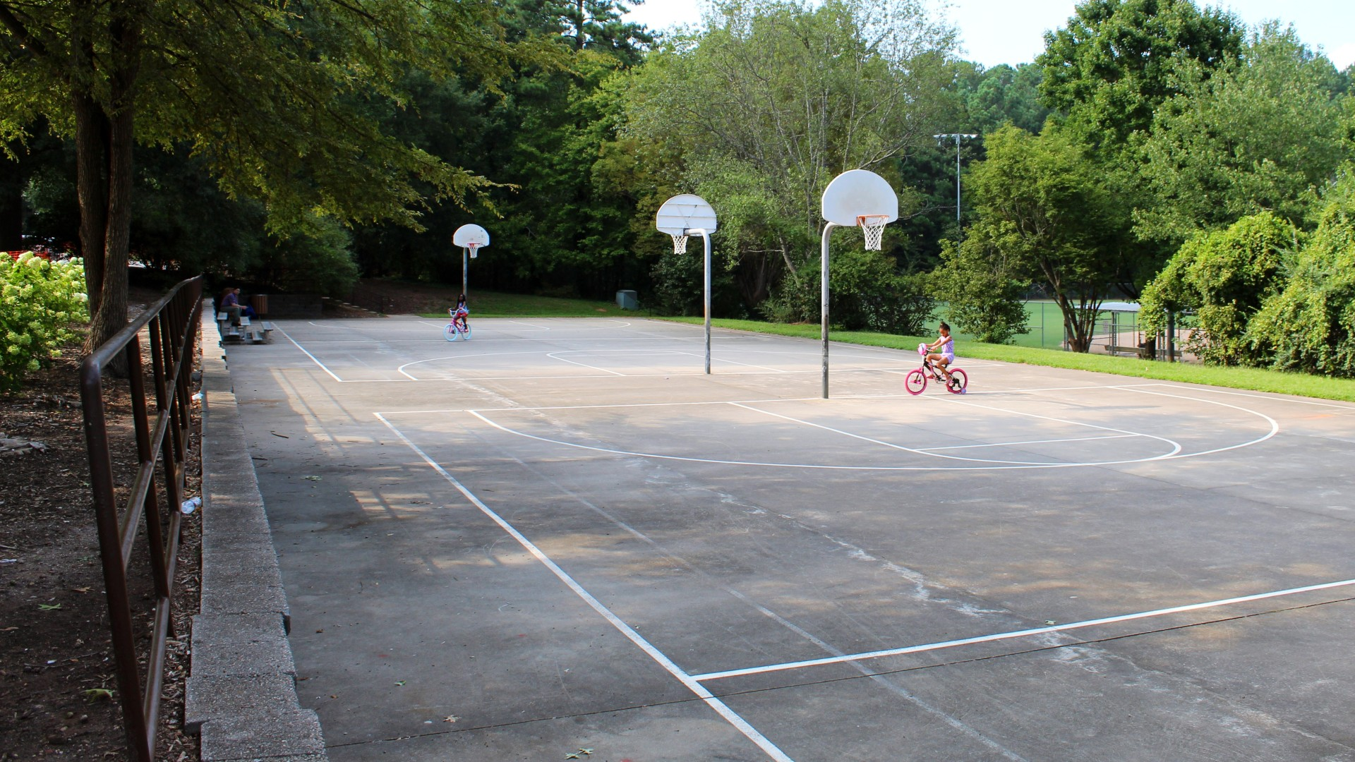 The outdoor basketball court with multiple hoops