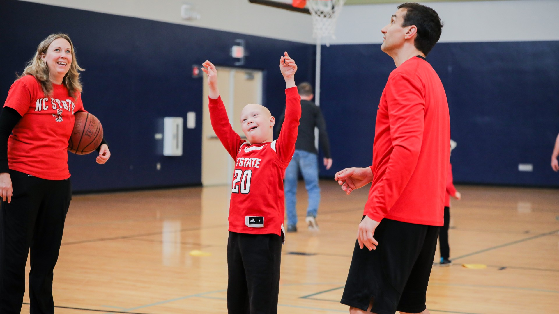 A kid participating in buddy basketball