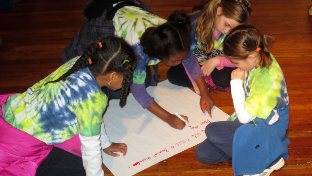 Girls working together on activity at COR Museum