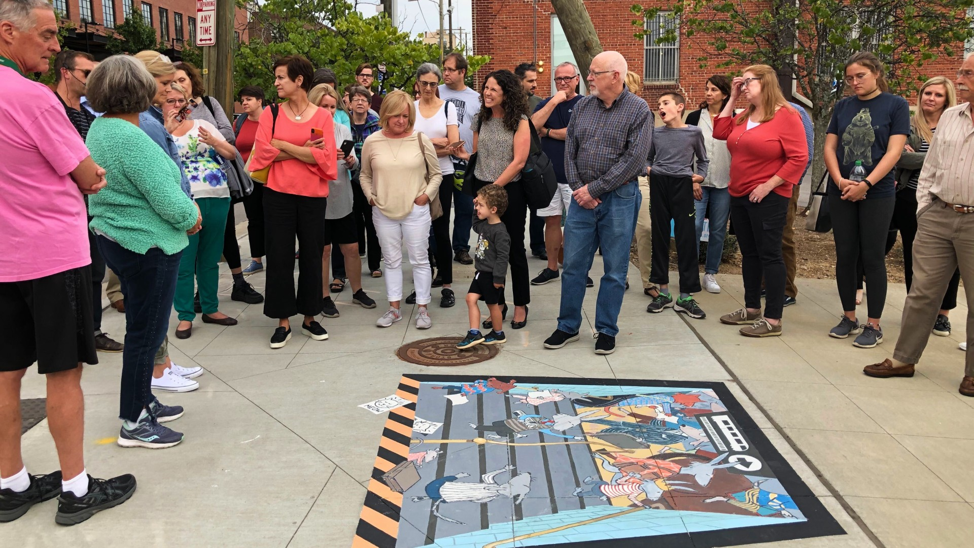 crowd viewing a sidewalk mural during downtown alliance artwalk