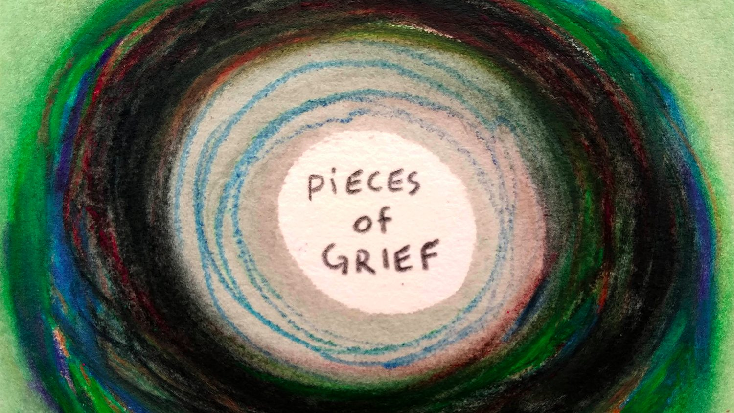 A drawing of multiple circles, with the words Pieces of Grief in the middle