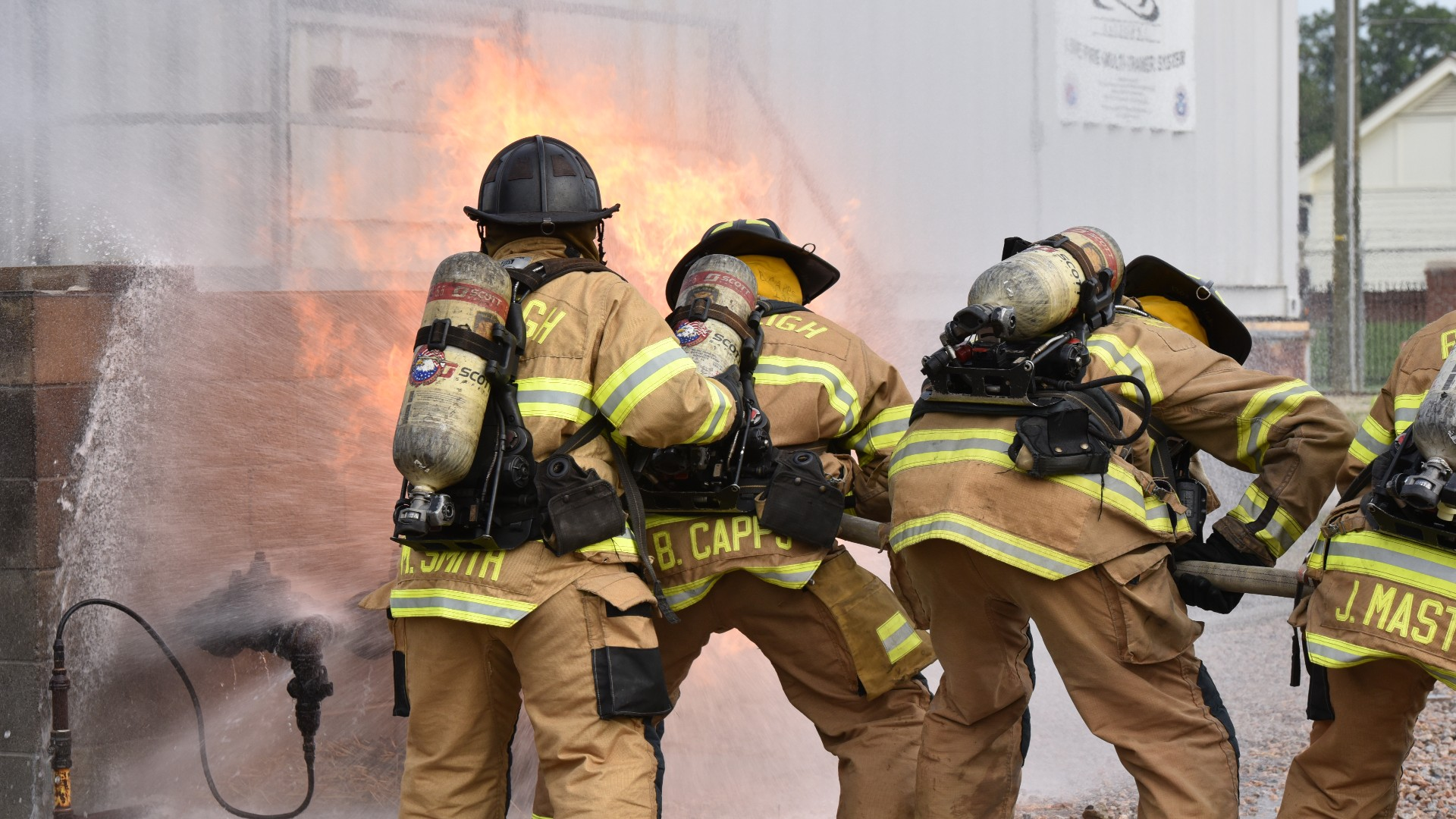 Firefighter recruits putting out blaze at training center