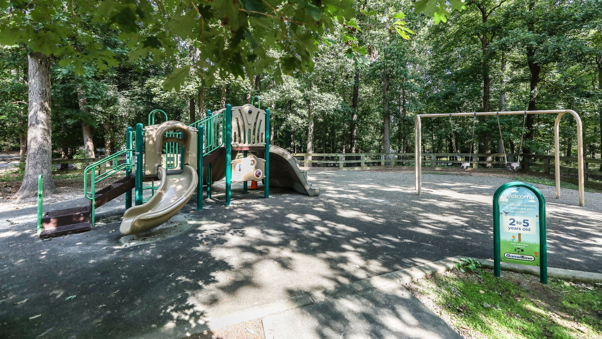A smaller playground for younger kids with a slides, swings and more