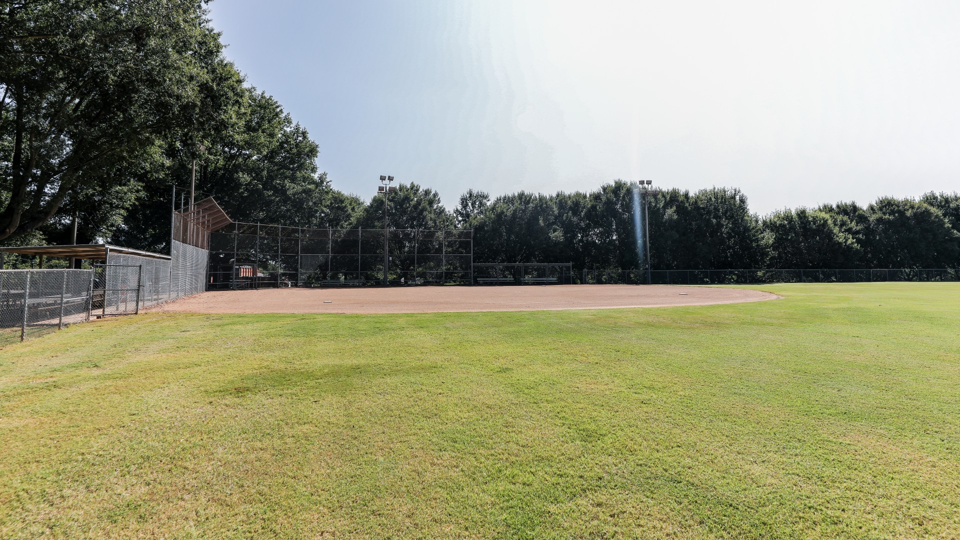 A open softball field with backstop