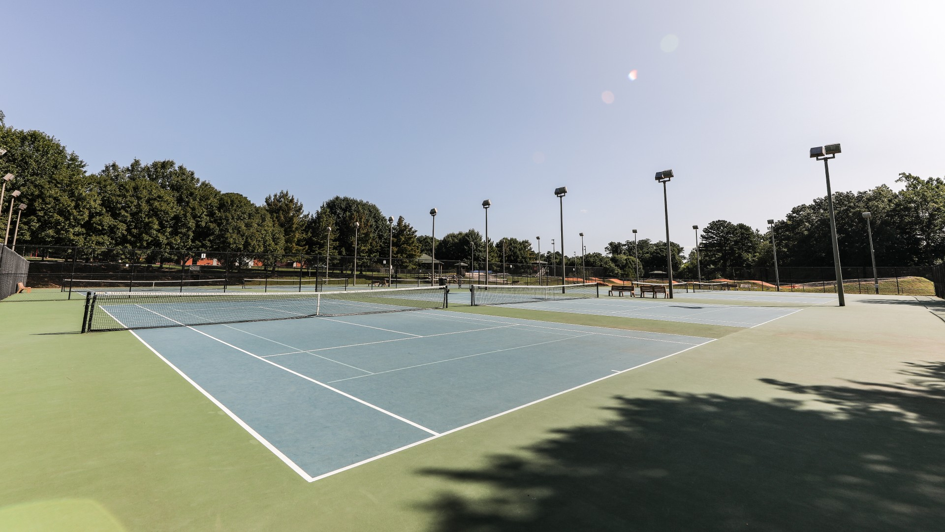 A shot of the eight outdoor tennis courts at Lions Park