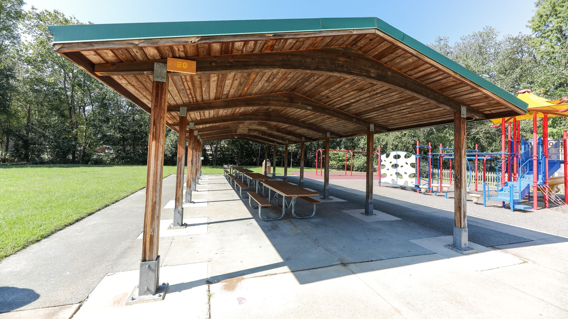 A large, open picnic shelter with several tables