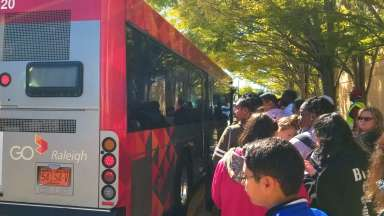 People in line to get on GoRaleigh bus