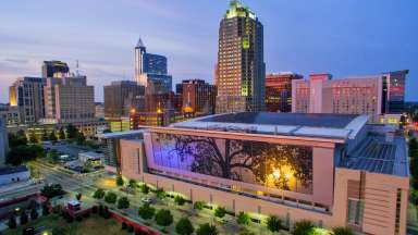 aerial shot of the Raleigh Convention Center at twilight
