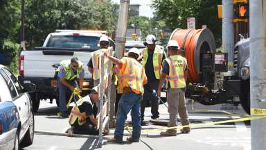 Public utilities workers setting up a barricade