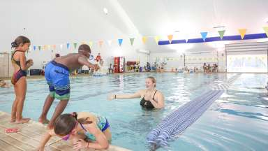 Children jumping into Millbrook Exchange pool for swimming programs