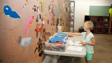 girl crafting at arts center
