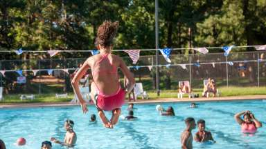 Girl cannonballs into pool at Biltmore Park