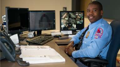 Raleigh Police Officer sitting at front desk to the station