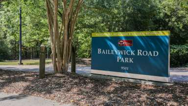 Exterior Baileywick Park sign at entrance to park.