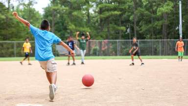 Kids playing kickball