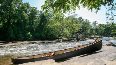 Canoe on banks of Neuse River