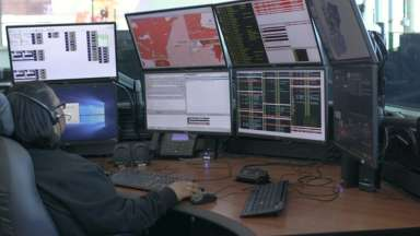 911 operator in front of screens
