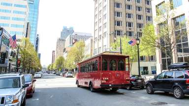View of the historic Raleigh Trolley driving around downtown Raleigh