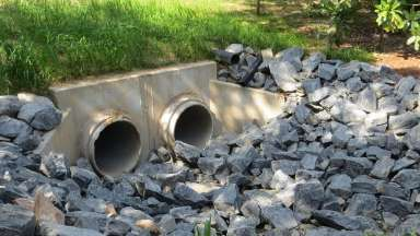 Two stormwater pipes at a property on Spring Drive