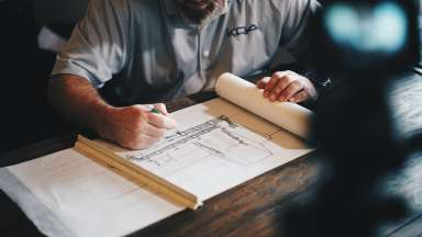 Man creating architecture drawing