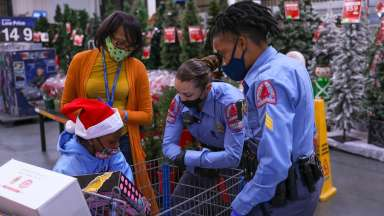 Police staff looks at child's purchases