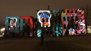 Art installation with projections on building