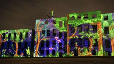 Artwork projected onto St. Agnes Hospital building by artists Omai