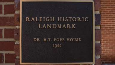 "A shot of the ""Raleigh Historic Landmark"" placard outside the Pope House"