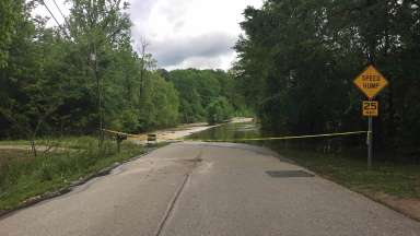Rose Lane closed off with yellow tape because of flooding