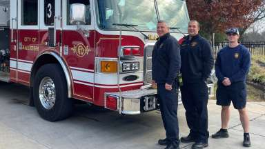 firefighters standing beside a fire truck