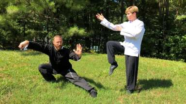 Two people doing kung fu moves