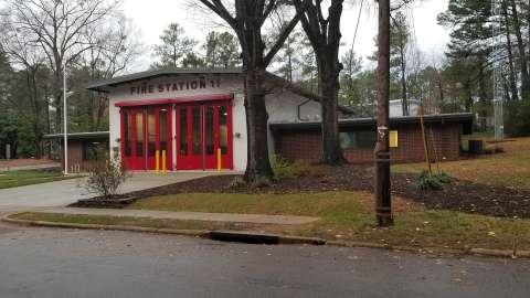 The new fire station 11 with big red doors that make easier for fire trucks to enter the station.