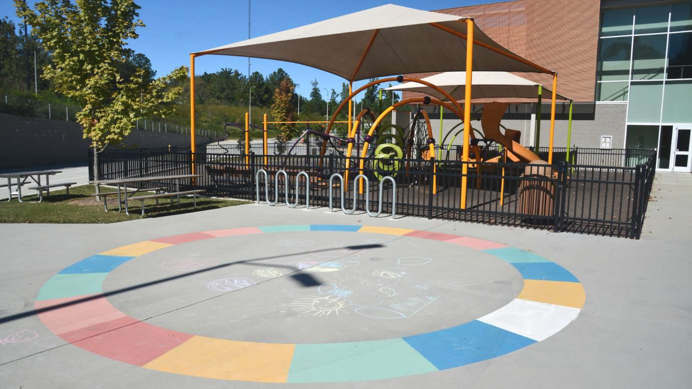 Circle drawn in chalk art made up of colorful blocks at Abbotts Creek Park