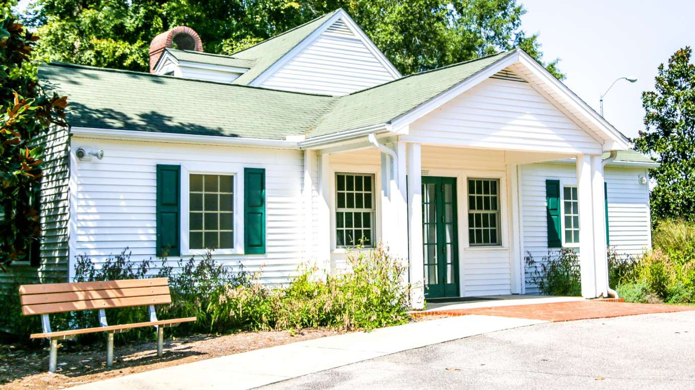 Quaint one-story cottage with shutters at Anderson Point Park