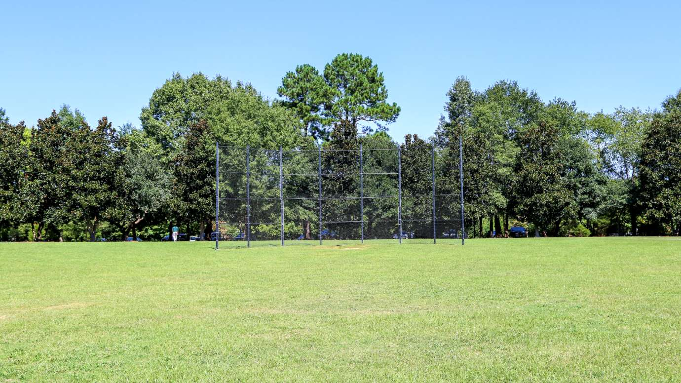 Field with batting cage at Anderson Point Park