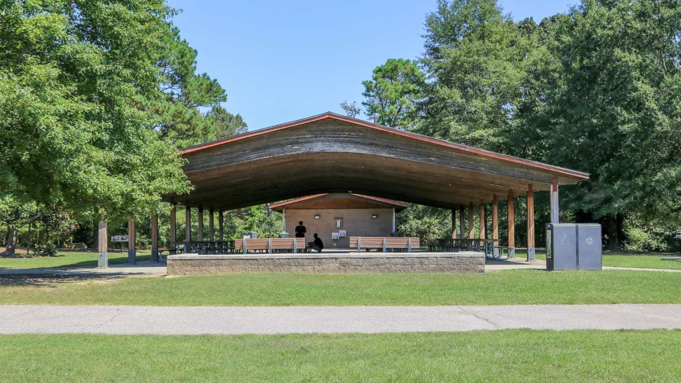 Front view of large picnic shelter with bathrooms at Anderson Point Park