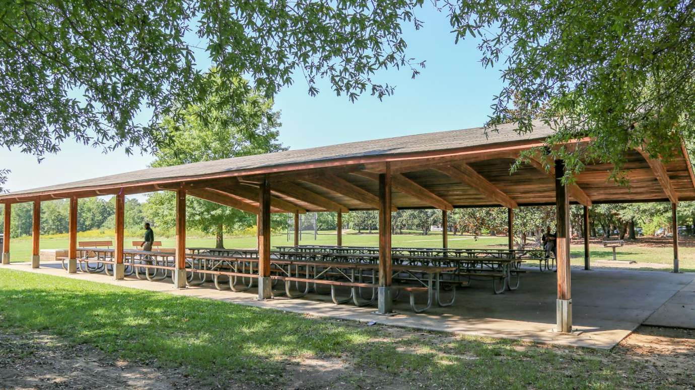 Side view of a large wooden picnic shelter at Anderson Point Park