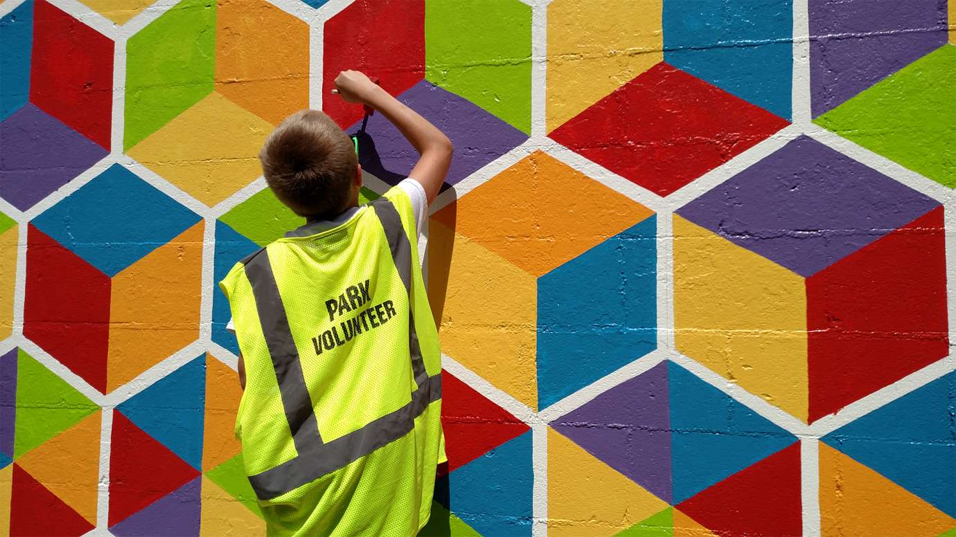 Boy painting a mural