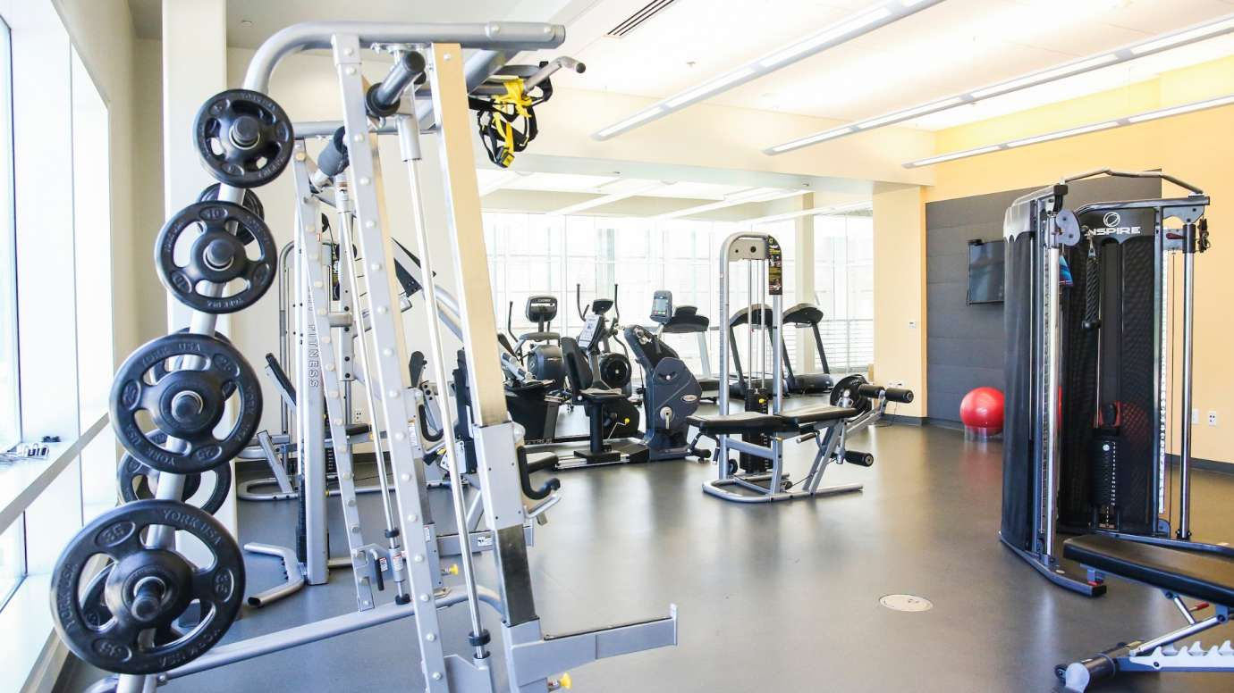 Various weight and cardio machines inside the Abbotts Creek Fitness room