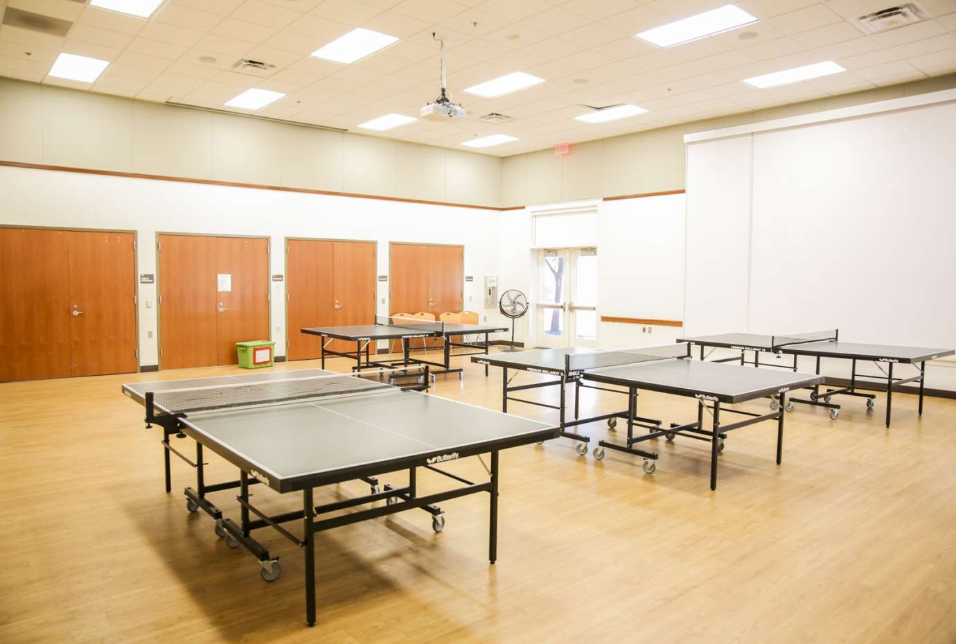 A large open room used for fitness classes, pickleball and table tennis