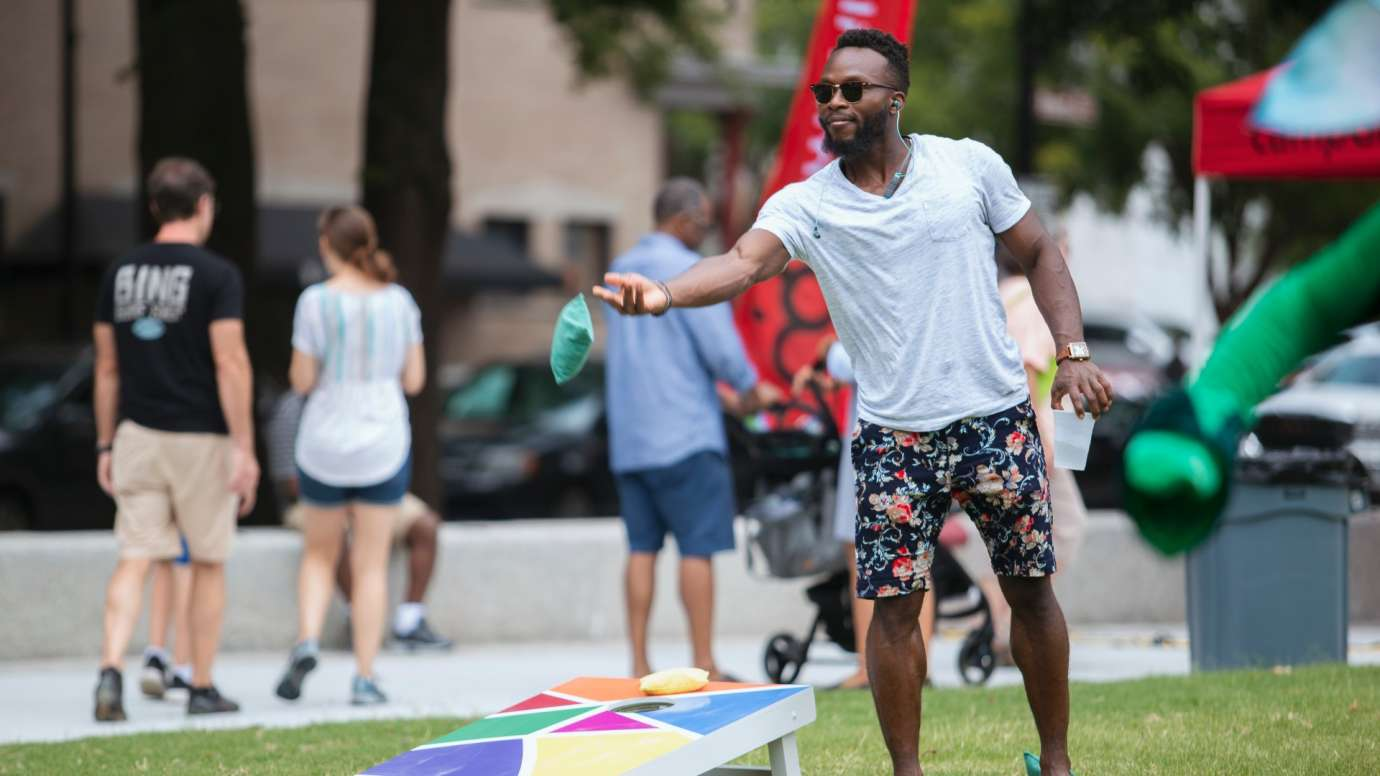A man playing corn hole during a special event